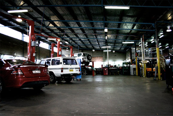 few vehicles parked in the service centre