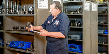 Newcastle staff holding transmission spare parts