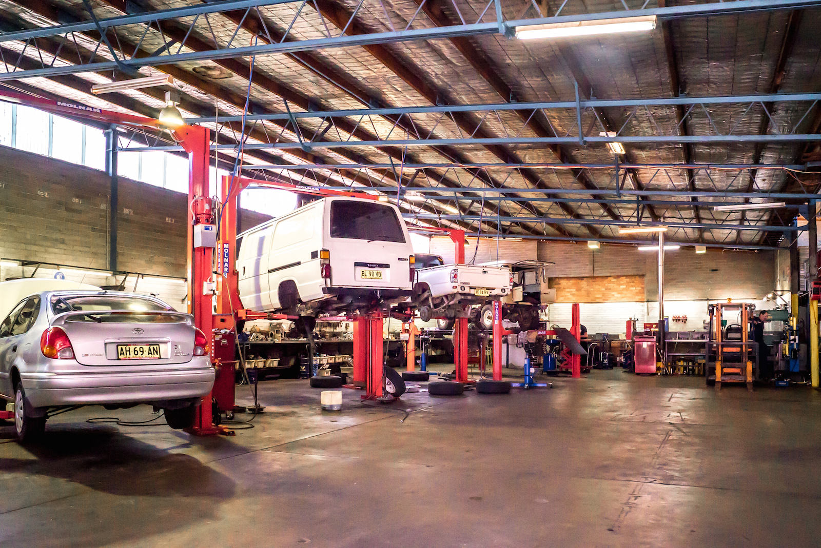 four vehicles are being repaired in newcastle workshop