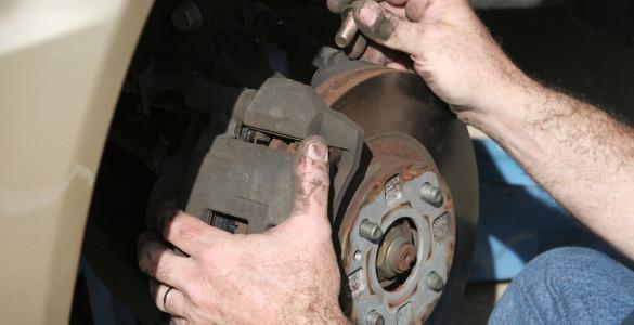 Mechanic Hands On Brakes